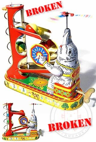 Elephant Acrobat Ball Game : Tin Toy Animals : Broken